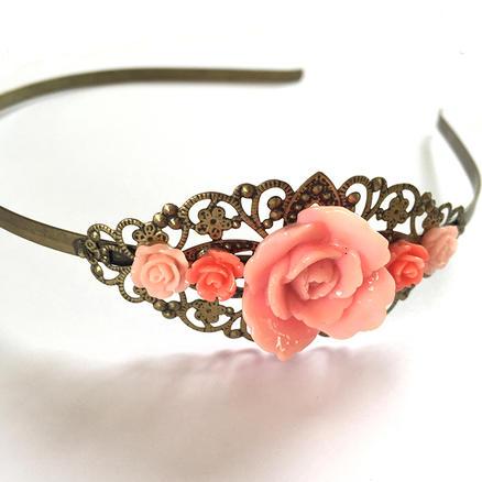 Serre-tête fleuri rose